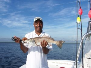 Man holding redfish caught inshore at Fernandina Beach
