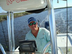 Captain Jeff Crumpton at the helm of his charter boat