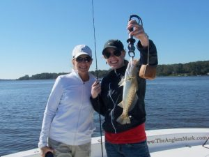 Couple holding big trout fish caught inshore at Fernandina Beach