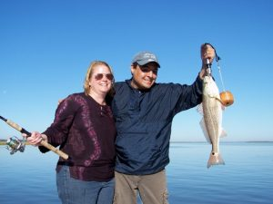 Couple holding fish caught inshore at Fernandina Beach
