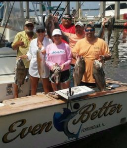 Family holding fish caught on Fernandina Beach Fishing Charter