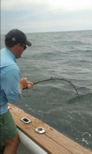 Man deep sea fishing off coast of Amelia Island