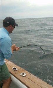 Man deep sea fishing off coast of Amelia Island