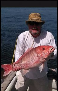Man holding fish caught on Fernandina Beach Fishing Charter