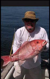 Man holding fish caught on Fernandina Beach Fishing Charter