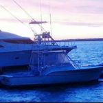 Image of Fishing Charter Boat next to yacht on Amelia Island