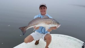 Man holding fish at Amelia Island Charters