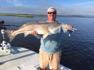 Man showing fish he caught at Amelia Island Charters