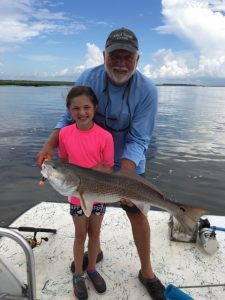 Little girl catches fish at Amelia Island Charters