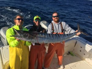 Three Men holding huge fish caught on Fernandina Beach Fishing Guide Charter