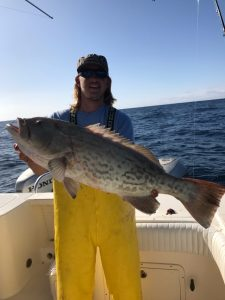 Man holding big fish caught on Fernandina Beach Fishing Charter