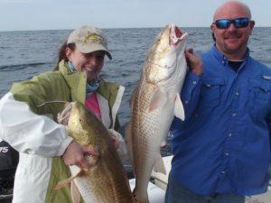 Couple holding fish caught on Fernandina Beach Fishing Charter