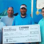 Captain George Smith holding check for $11,080 for winning the 2012 Jacksonville Saltwater Classic