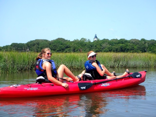 Image of two women kayaking at Amelia Island