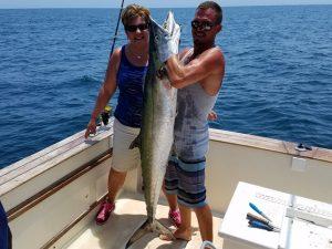 Man holding King Fish caught off the coast of Fernandina Beach