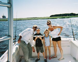 Family posing on charter fishing boat