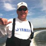 Captain Jeff Crumpton standing on Amelia Island Charter Fishing Boat