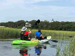 Two kayakers paddling the backwaters of Amelia Island