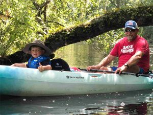 Father and son kayaking Amelia Island